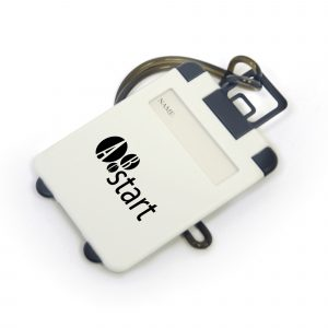 Plastic rectangular luggage tag with name viewing, address section and rubber strap.
