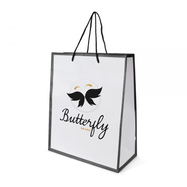 Medium sized white glossy paper bag with coloured trim and rope handles. Made with 157gsm art paper.