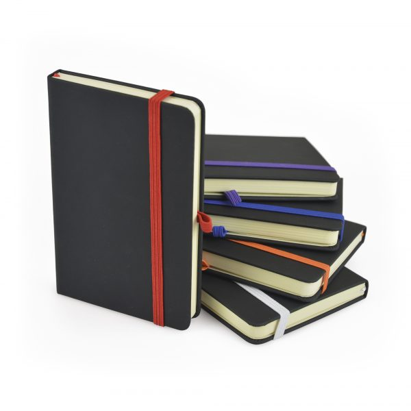 A6 black PU soft finish 80 sheet lined notebook with coloured bookmark, back pocket for securing loose notes, coloured elastic pen loop with coloured elastic closure. Available in 10 colours.