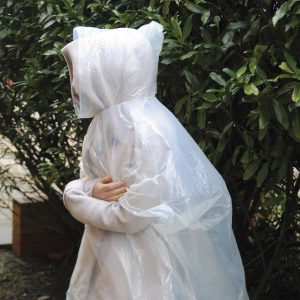 Poncho in a plastic ball with a snap hook attachment. Available in 6 colours.