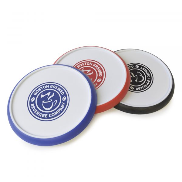 Circular white plastic coaster with coloured silicone edge for a better grip.