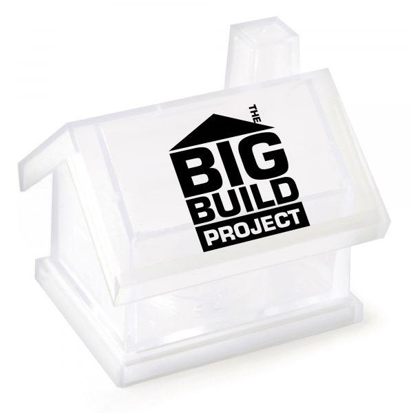 Plastic house shaped money box in translucent plastic.