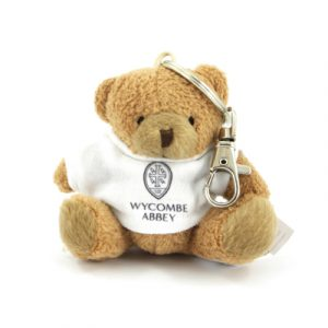 An 8cm beige bear with a white t-shirt printed up to full colour and a standard split ring attached. All bears conform to CE regulations and suitable for all ages.