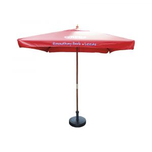 Substantial two metre square parasol with wooden stem. Heavy duty wooden stem and ribs with pull cord opening
