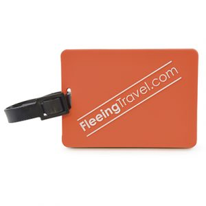 Rectangular, moulded PVC luggage tag with rubber strap. Reverse has framed viewing window with a pull out address label.